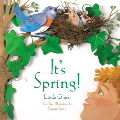 It's spring book cover. A child looks up into a tree at a bluebird and her baby birds in a nest