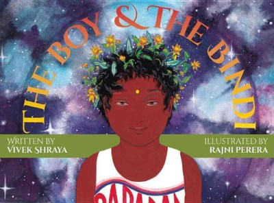 the boy and the bindi book cover. A boy with a crown of flowers looks out at the reader. he has a bright yellow bindi on his forehead